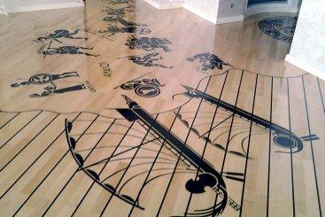 Паркетные полы из штучного паркета с художественной композицией